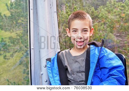 Portrait Of A Cute Boy In A Cable Car