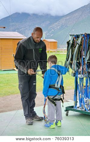 Little Boy Preparing To Enter A Challenging Rope Course