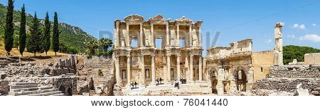 Tourists Explore The Library Of Celsus