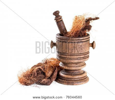 Dry corn silk (Stigmata Maydis) with  mortar on a white background