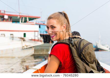 Woman at sightseeing on boat trip in harbour Sunda Kelapa, Jakarta, indonesia