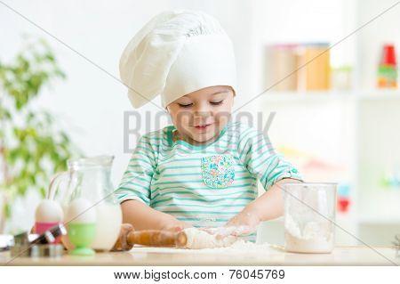 little baker kid girl in chef hat