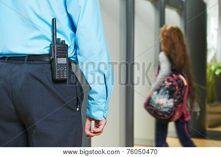 security guard controlling indoor entrance gate