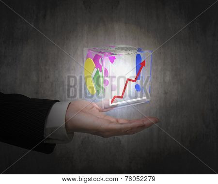 Human Hand Holding Glowing Colorful Transparent Glass Cube
