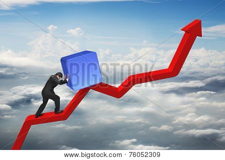 Businessman Pushing Blue 3D Block Upward On Red Trend Line