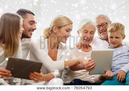 family, generation, technology and people concept - smiling family with tablet pc computers at home