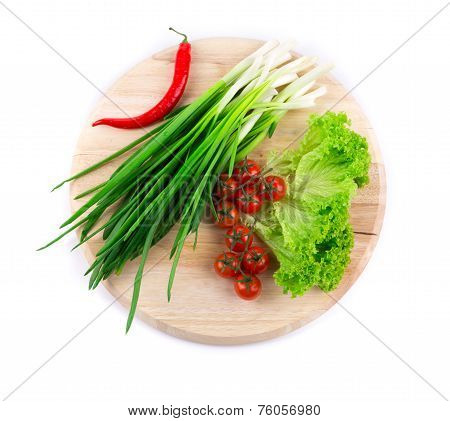Vegetable composition on the wooden board.