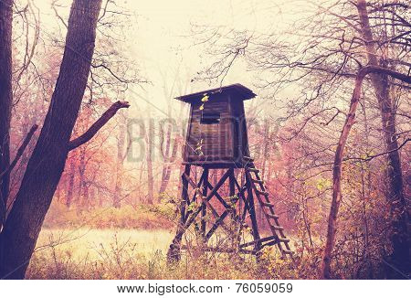 Vintage Filtered Photo Of Hunting Pulpit In Forest.