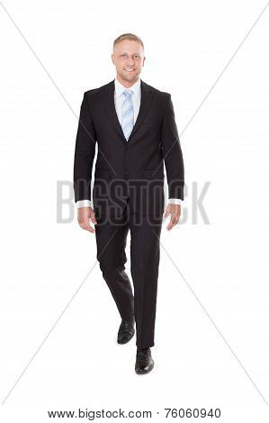 Smiling Businessman Walking Over White Background