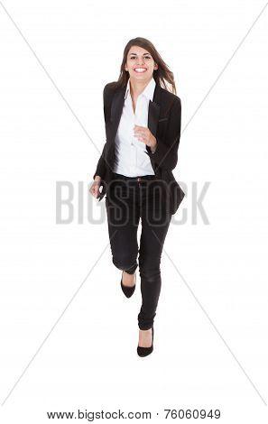 Portrait Of Happy Businesswoman Running Over White Background