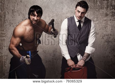 Strong and crazy men with construction tools