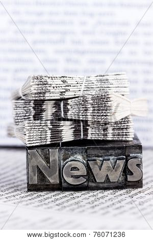 the word news written with lead letters. photo icon for newsletters, newspapers and information