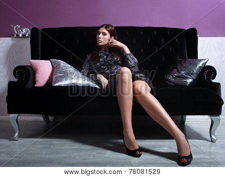 Beautiful Woman Seated On A Sofa