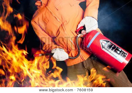 Fireman Fighting A Raging Fire With Big Flames