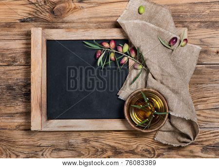 Olives And Olive Oil With Menu Board - Rustic Setting