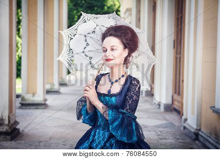 Beautiful Woman In Medieval Dress With Umbrella