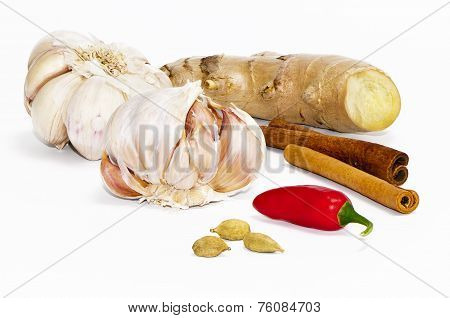 Garlic Bulbs, Chili Pepper, Ginger, Green Cardamom Pods And Cinnamon