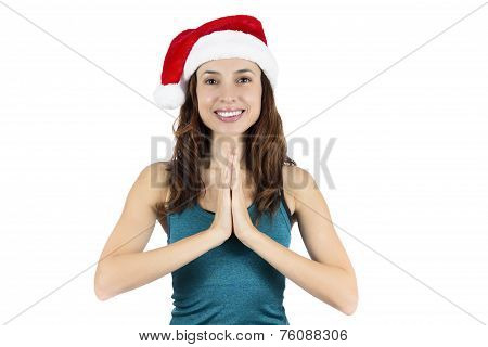 Yoga Woman With Santa Claus Hat In Namaste Pose