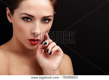 Beautiful Sexy Woman Portrait. Black Eyeliner, Red Lipstick And Black Nails Polish