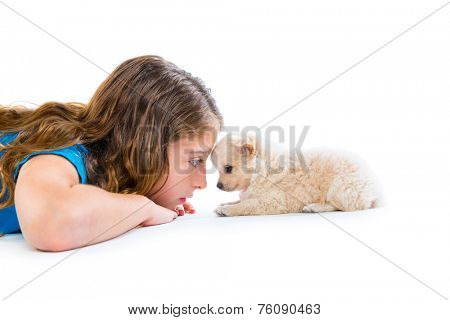 relaxed kid girl and puppy chihuahua dog lying happy profile view on white background