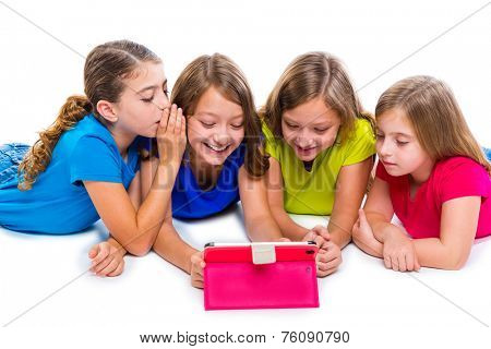 sisters cousins kid girls with tech tablet pc playing happy lying on white background