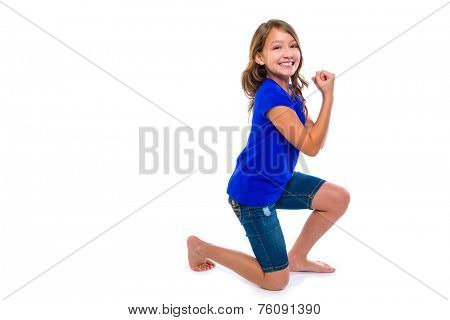 Excited winner expression kid girl hands gesture blue jeans on white background