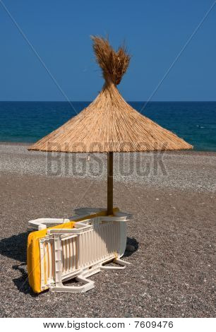 Beach Umbrella And Deckchair