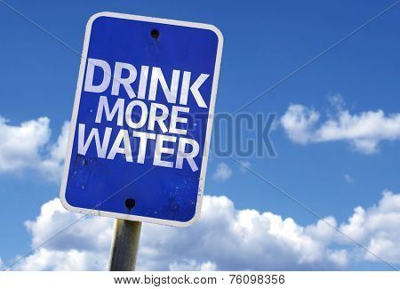Drink More Water sign with sky on background
