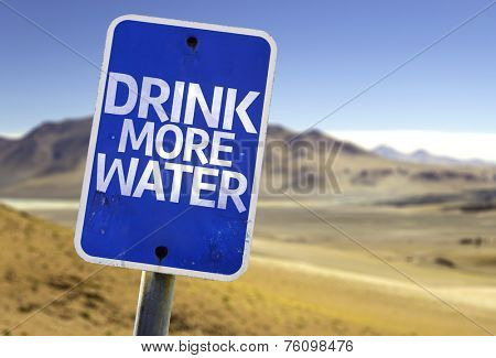 Drink More Water sign with a desert background