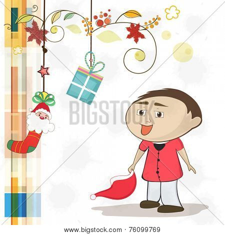 Poster, banner or greeting card design for Merry Christmas with cute little boy holding Santa hat and hanging gifts on floral decorated background.