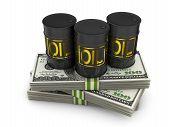 stock photo of crude-oil  - barrels of oil on packs of dollars - JPG