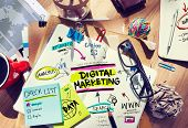 picture of messy  - Office Desk with Tools and Notes About Digital Marketing - JPG