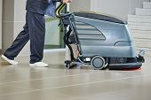 foto of supermarket  - Floor care and cleaning services with washing machine in supermarket shop store - JPG