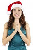 foto of namaste  - Yogi woman wearing a santa hat in namaste pose - JPG