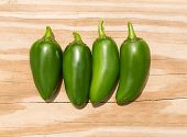 stock photo of jalapeno  - Chile Jalapeno hot chili pepper on wood background - JPG