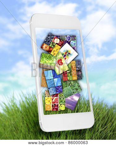 Touch screen mobile phone with beautiful images on nature background