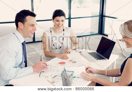 Collegues having a discussion in office