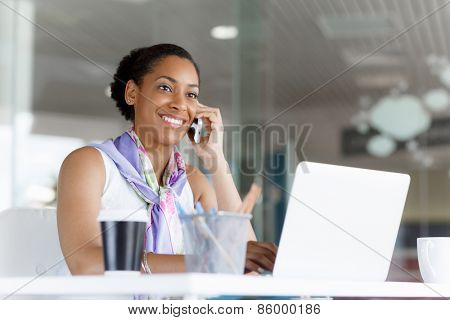 Beautifiul young businesswoman talking over phone