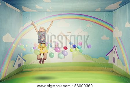 Little cute girl jumping high among balloons flying in sky