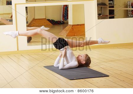 Little Gymnast Making Exercises In Gym