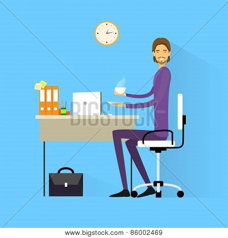 business man drink coffee sitting at desk in office working laptop computer