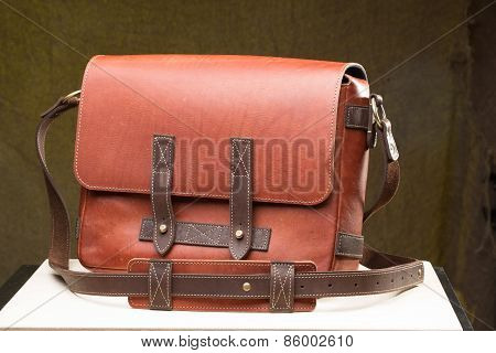 Old vintage leather bag with leather strap