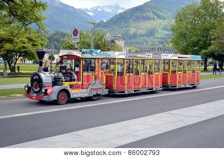 city tour by mini train on street of Interlaken Switzerland