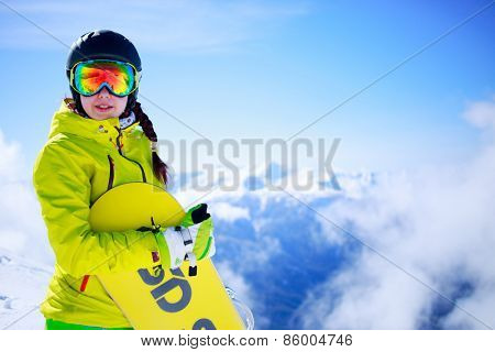 View of sportsman with snowboard standing in the mountain