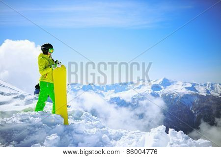 snowboarder against sun and mountains