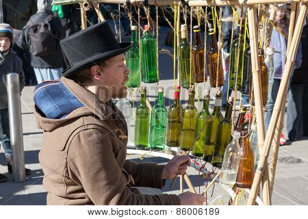 Helsinki,finland-march 29: The Street Musician Plays On Empty Bottles Helsinki,