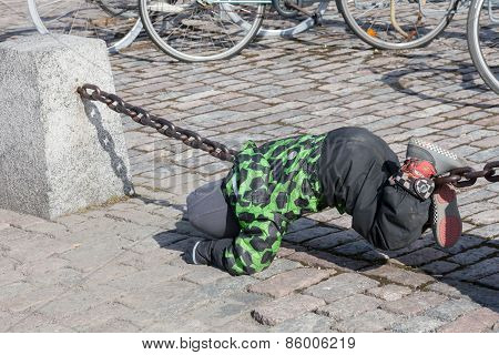 Helsinki, Finland - March 29:the Child Plays On A Chain Protection Helsinki,