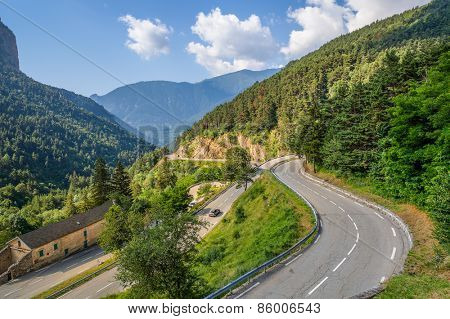 Narrow alpine road on French-Italian border in Alps, France (view from above).