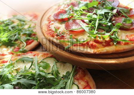 Pizza with sausage, cheese, ruccola