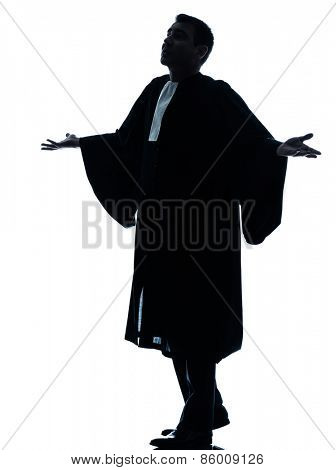 one  lawyer man pleading silhouette in studio isolated on white background